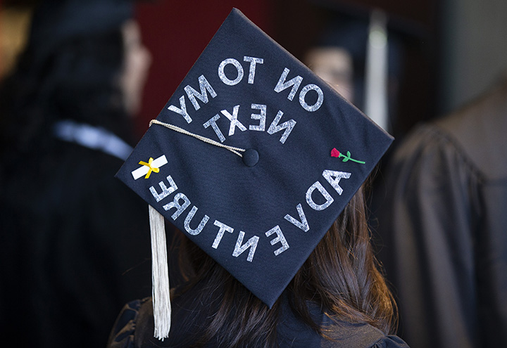 View of the back of a graduation mortar board that reads On to M
